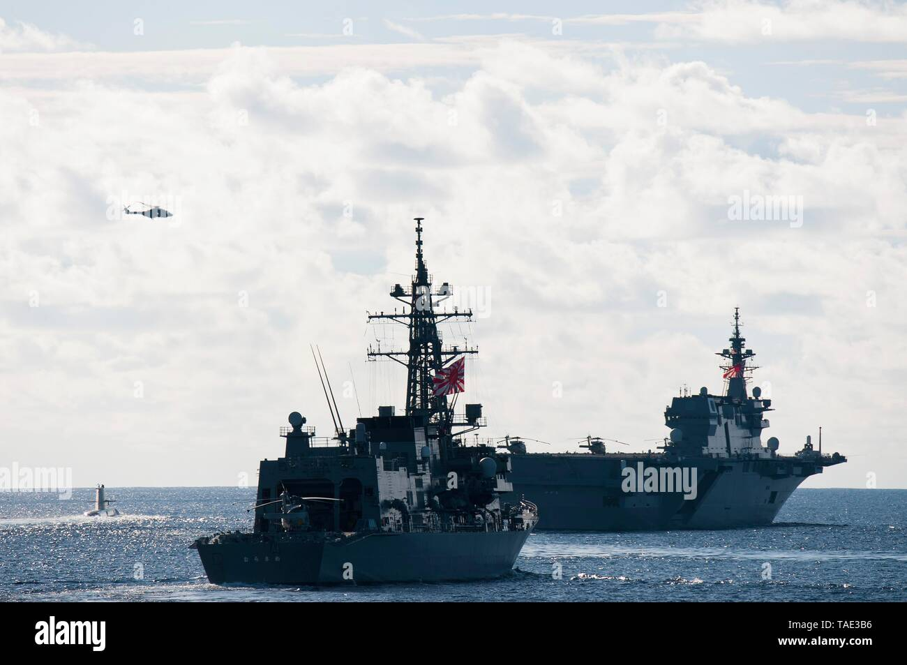190521-N-VA840-0047 INDIAN OCEAN (May 21, 2019) The Japan Maritime Self Defense Force Izumo-class helicopter destroyer JS Izumo (DDH 183), and the Murasame-class destroyer JS Murasame (DD 101), and the Royal Australian Navy's HMAS Collins (SSG 73) participate in a multi-nation group sail in the Indian Ocean. The Arleigh Burke-class guided-missile destroyer USS William P. Lawrence (DDG 110), the Henry J. Kaiser-class fleet replenishment oiler USNS Pecos (T-AO 197) sailed in formation, alongside ships and aircraft from the French, Japanese, and Australian navies. William P. Lawrence is deployed  - Stock Image