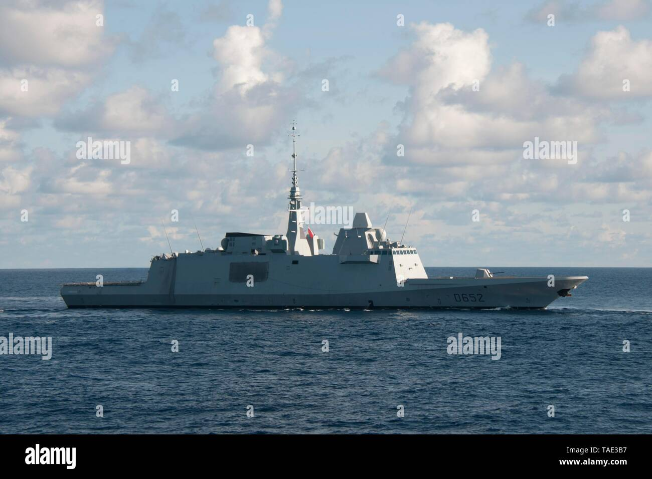 190520-N-VA840-0005 INDIAN OCEAN (May 21, 2019) The French Aquitaine-class FREMM multipurpose frigate FS Provence D652, sails alongside the Arleigh Burke-class guided-missile destroyer USS William P. Lawrence (DDG 110) during a multi-nation group sail in the Indian Ocean. William P. Lawrence is deployed to the U.S. 7th Fleet area of operations in support of security and stability in the Indo-Pacific                     region. (U.S. Navy photo by Mass Communication Specialist 1st Class Leonard Adams) - Stock Image