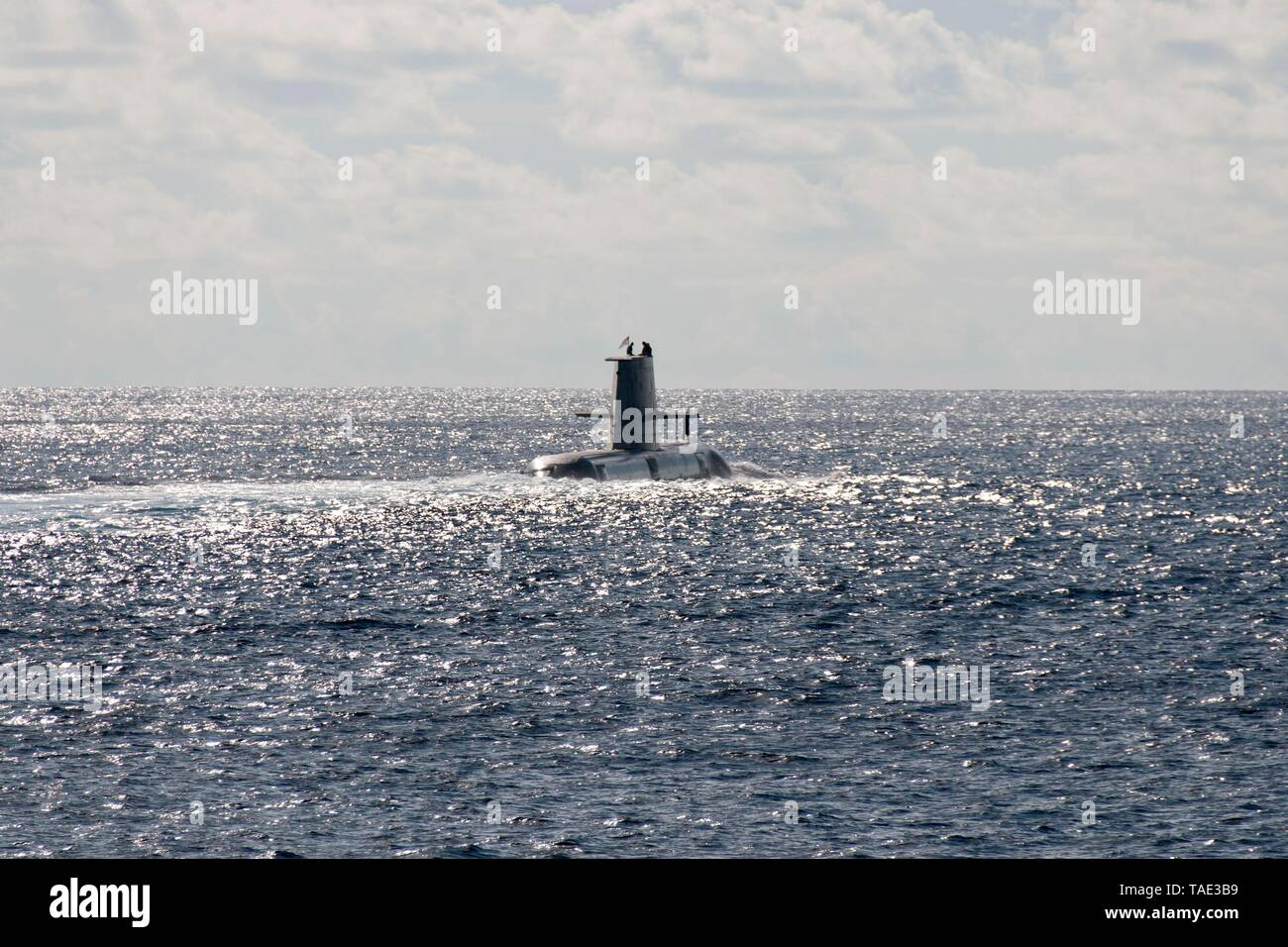 190521-N-VA840-0074 INDIAN OCEAN (May 21, 2019) The Royal Australian Navy's HMAS Collins (SSG 73) rises to the surface during a multi-nation group sail in the Indian Ocean. The Arleigh Burke-class guided-missile destroyer USS William P. Lawrence (DDG 110), and the Henry J. Kaiser-class fleet replenishment oiler USNS Pecos (T-AO 197) sailed in formation, alongside ships and aircraft from the French, Japanese, and Australian navies. William P. Lawrence is deployed to the U.S. 7th Fleet area of operations in support of security and stability in the Indo-Pacific region. (U.S. Navy photo by Mass Co - Stock Image