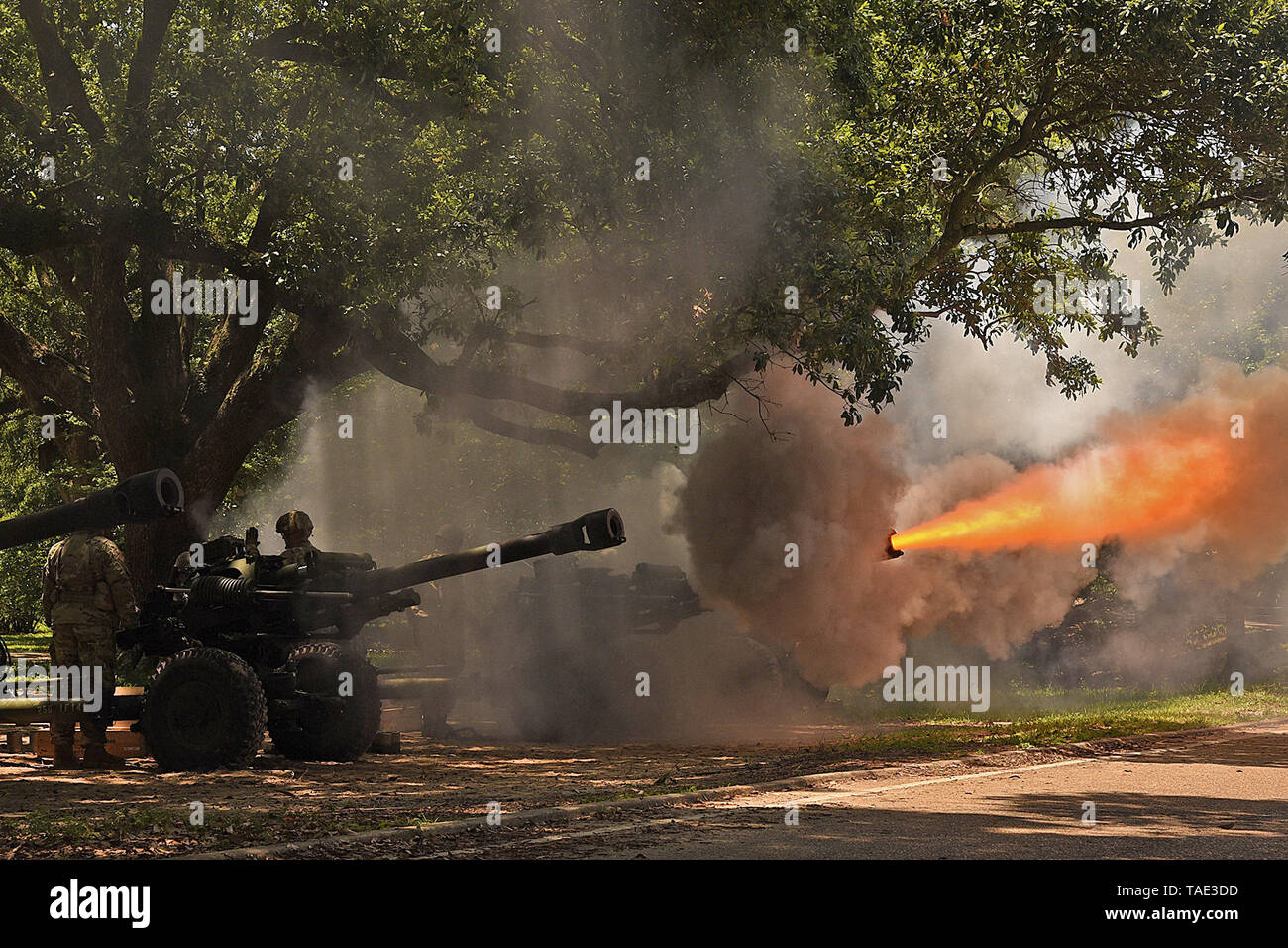 The Louisiana National Guard's 1st Battalion, 141st Field Artillery Regiment fires a Howitzer as part of a 19 cannon salute for Gov. John Bel Edwards at a ceremony dedicating a monument memorializing fallen Louisiana Guardsmen at Louisiana Veterans Memorial Park in Baton Rouge, Louisiana, May 21, 2019. (U.S. Army National Guard photo by Staff Sgt. Garrett L. Dipuma) - Stock Image