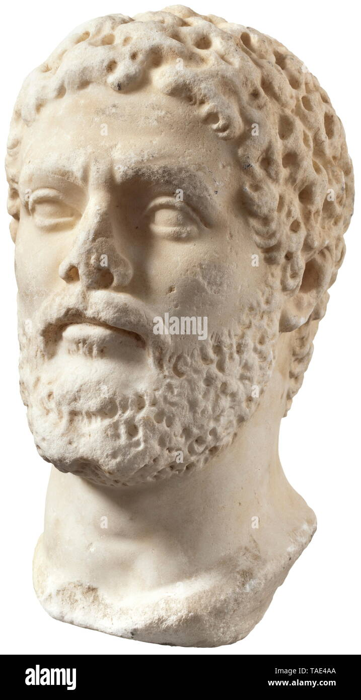 A Roman private portrait from the age of Septimius Severus - a fine marble copy from the 19th century patterned after an ancient model A male head with a closely-cropped beard of wavy locks terminating at bottom in two points. Head worked like a component for a bust, but evenly ground at the sides and bottom of the neck. The underside of the head slightly slanted to the left. Hair, beard and edges of the neck slightly over-ground. Nose tip broken off. The surface appears to have been deliberately processed to create the impression of an ancient s, Additional-Rights-Clearance-Info-Not-Available - Stock Image