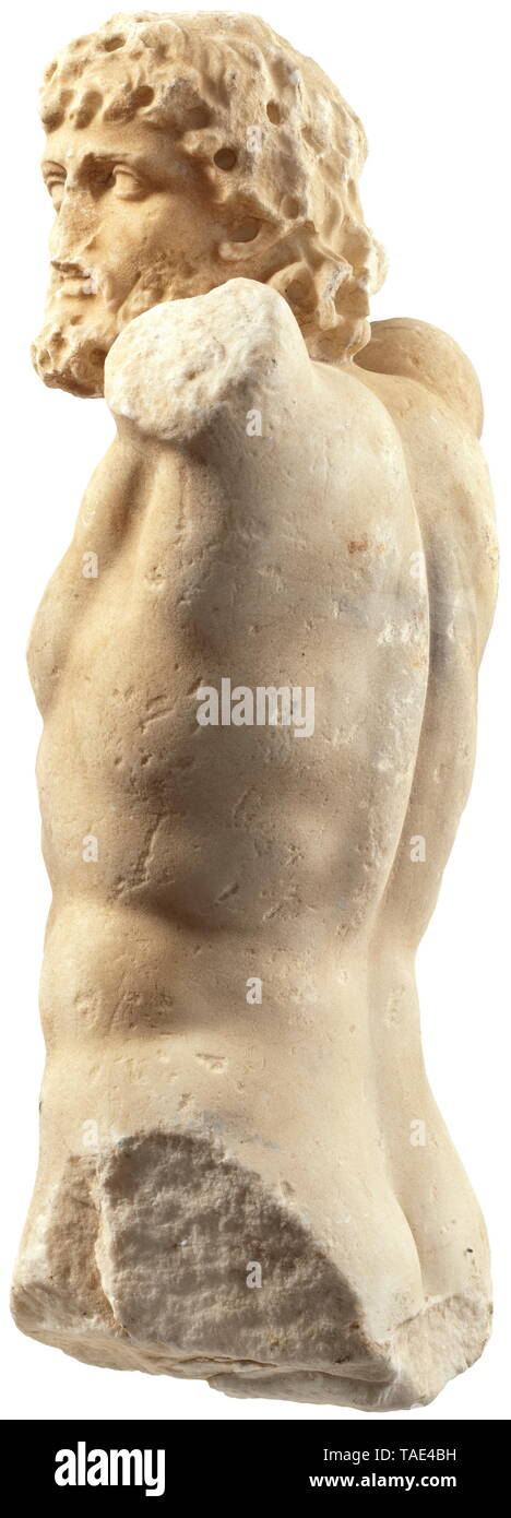 A torso of a satyr - a fine marble copy from the 19th century patterned after an ancient model Muscular male torso facing to the right with curly hair and beard. The missing raised arms and legs probably belonging to a figure in a dancing pose. At bottom a drill hole for mounting on a metal rod. Head broken off and re-mounted. Nose broken off. Technical and stylistic details in the face such as the orbital arches indicate that the sculpture was made in the 19th century. Height 48 cm. Provenance: Polish private collection, acquired by the consigno, Additional-Rights-Clearance-Info-Not-Available - Stock Image