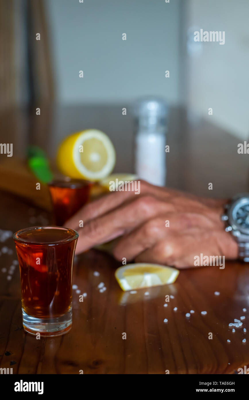 Break out the shot glasses, salt and lemon, barman, it's shooter time Stock Photo
