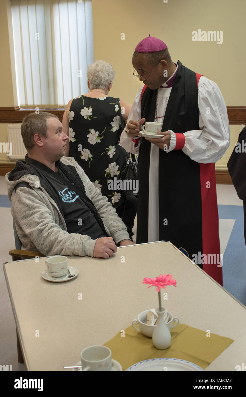 Rt. Rev. Dr. Musonda Trevor Selwyn Mwamba, Vicar of St Margarets Barking Essex chatting with local people in Church Centre. 2010s. 2019 UK HOMER SYKES - Stock Image
