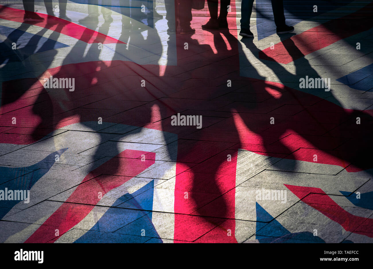 Shadows of People and UK Flag Citizens of Great Britain - Stock Image