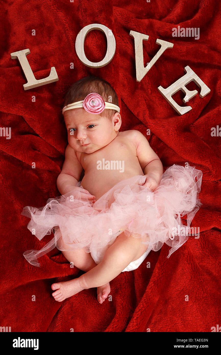 10 day old baby girl sleeping - Stock Image