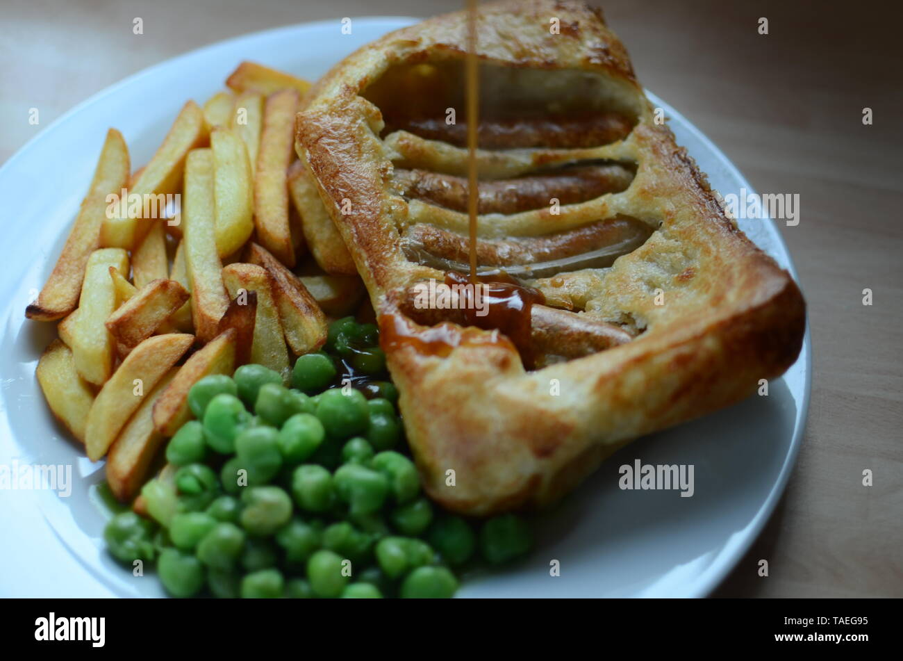Toad in the hole (sausages baked in batter, England) Stock Photo