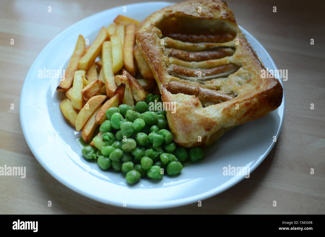 home cooked sunday lunch, toad in the hole Stock Photo