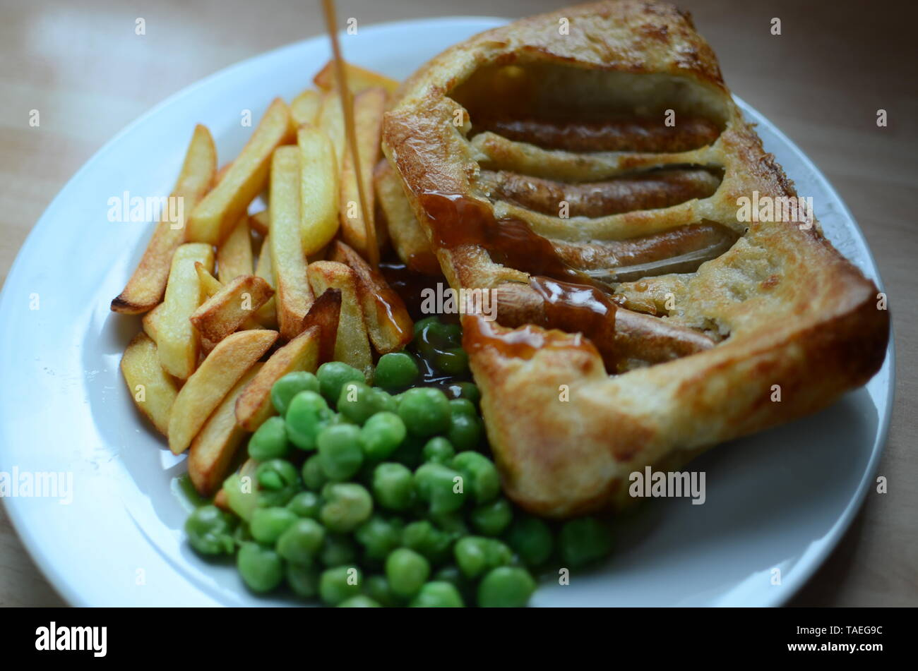Home cooked Toad in the hole (sausages baked in batter, England) Stock Photo
