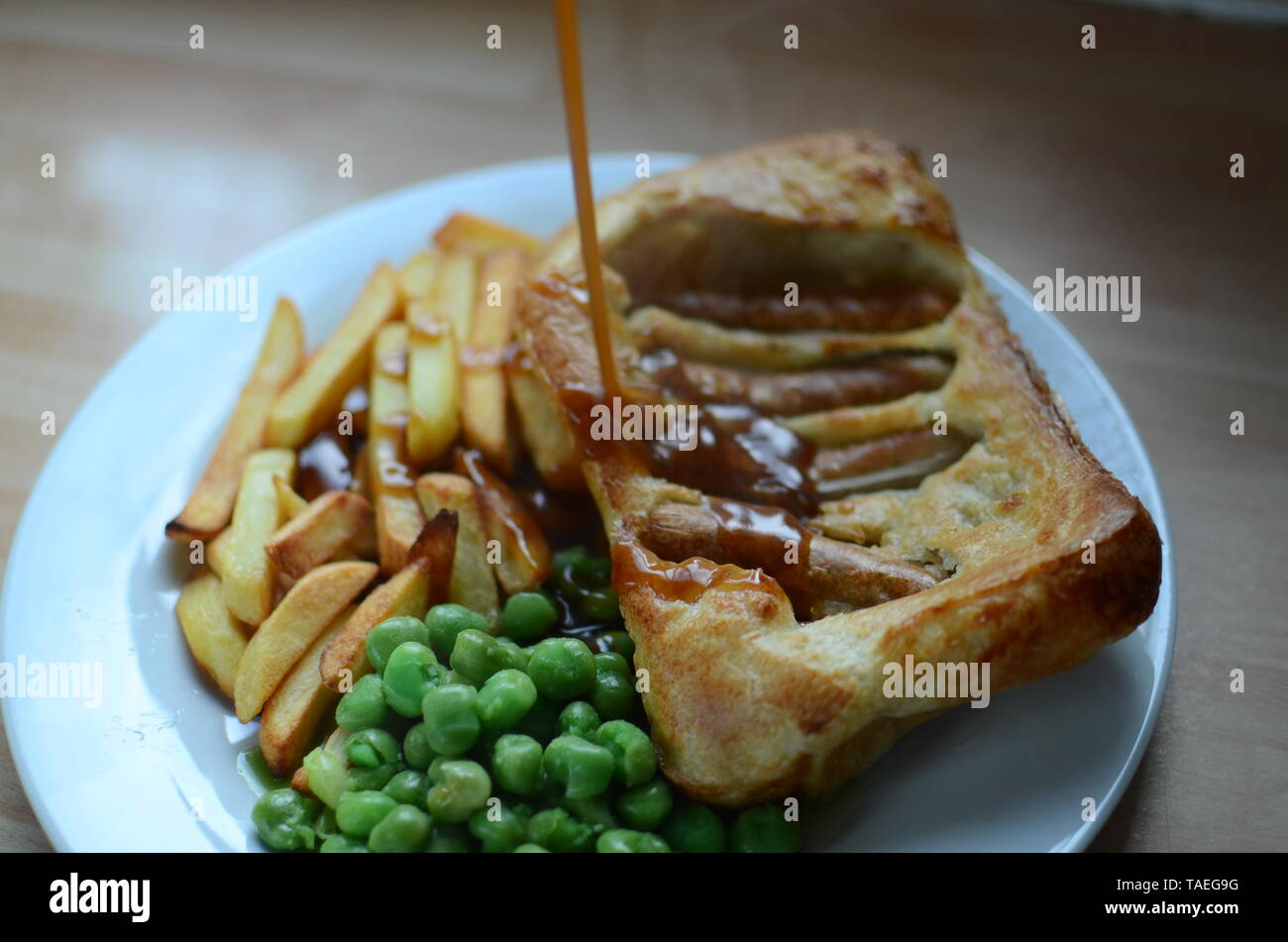 home cooked sunday lunch, toad in the hole - Stock Image