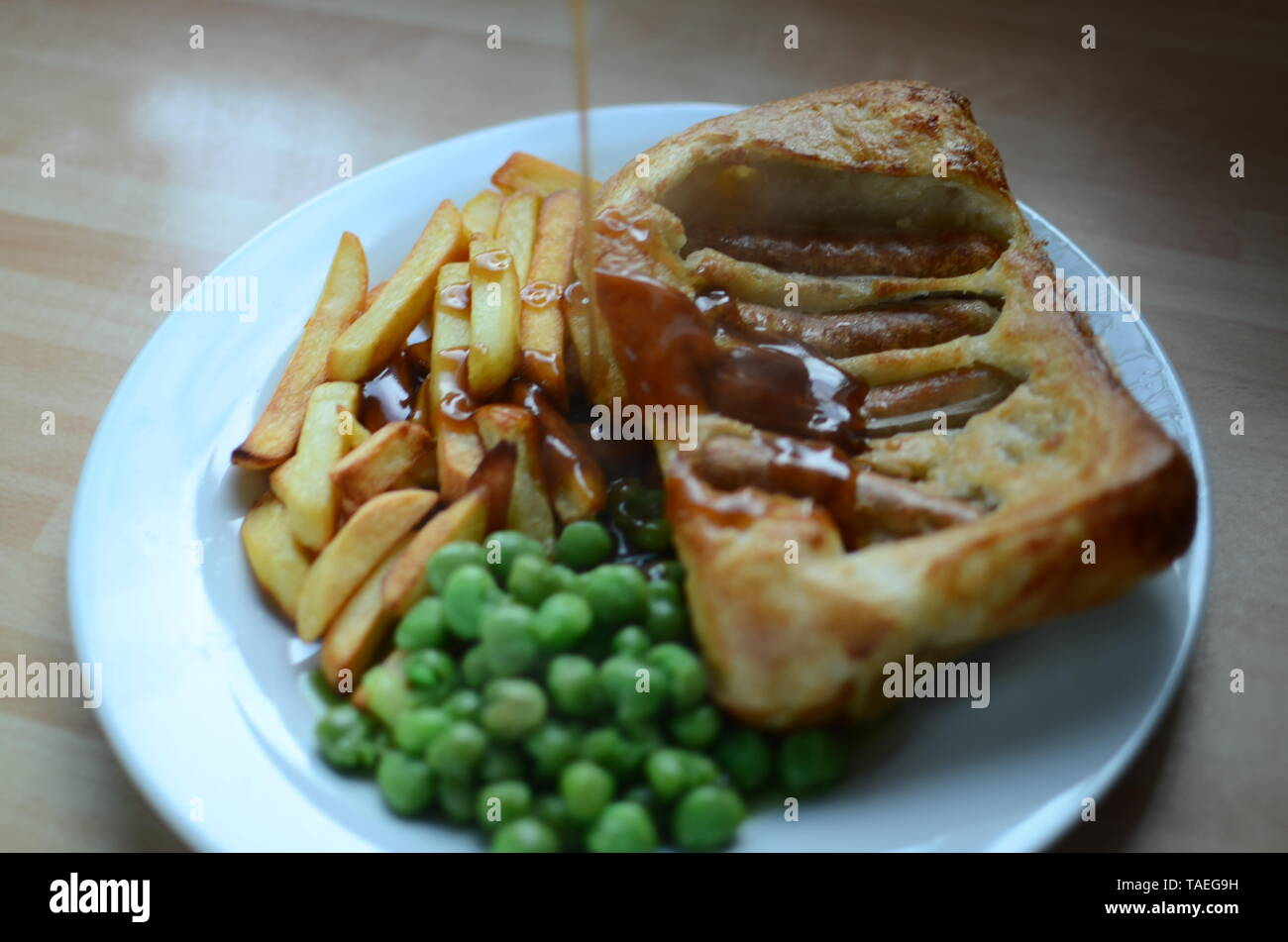 """Home cooked Sausage Toad, Traditional British """"Toad in the Hole"""" meal Stock Photo"""