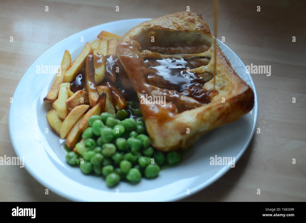 home cooked toad in the hole - Stock Image