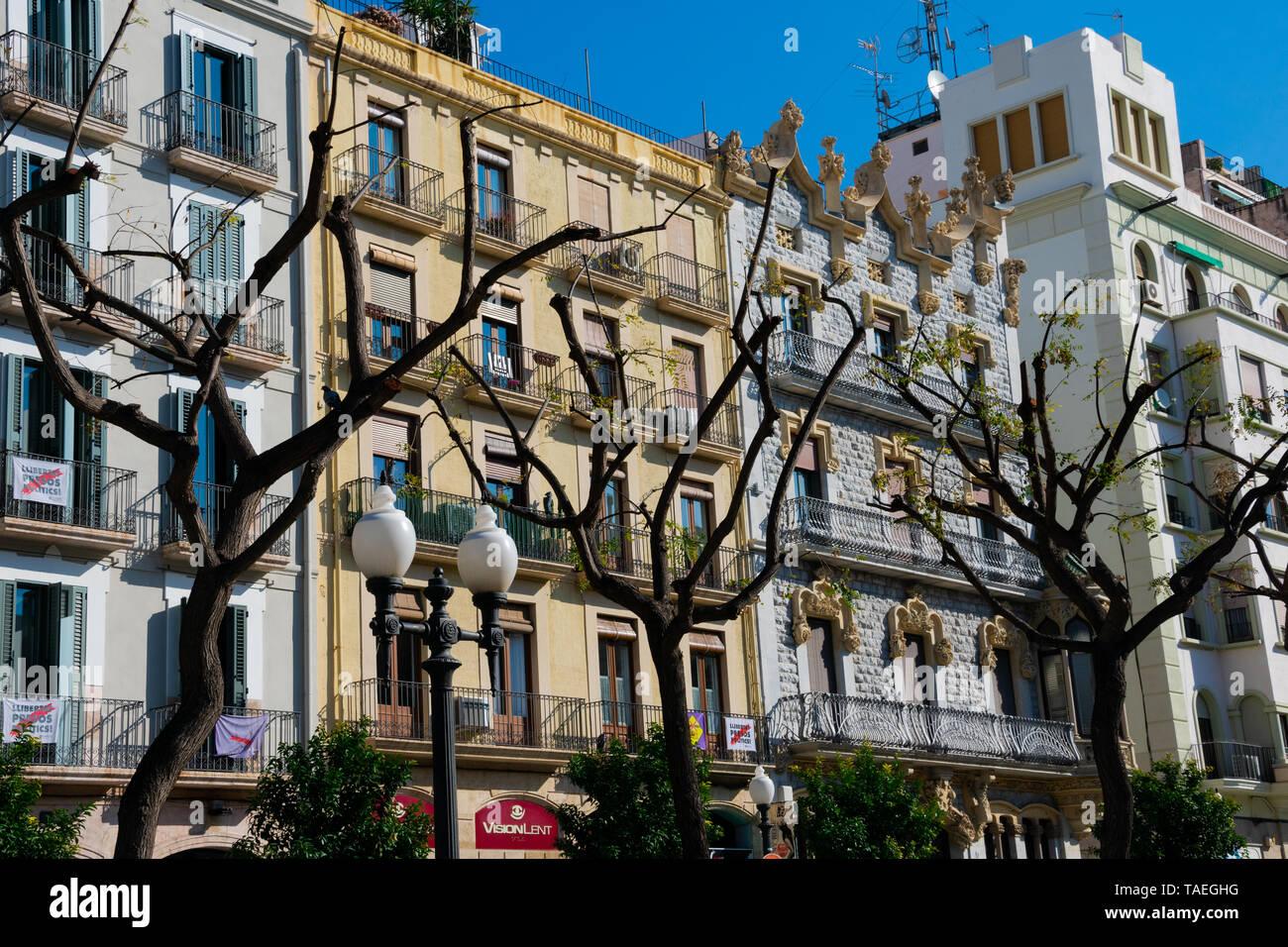 Tarragona, Spain. February 8, 2019. Old building facades in Rambla Nova, a main city walk with restaurants and shops - Stock Image
