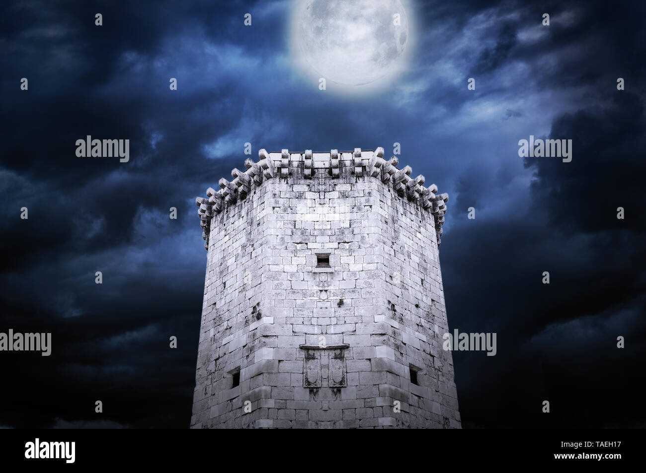 Tower of castle at night in the moonlight. - Stock Image