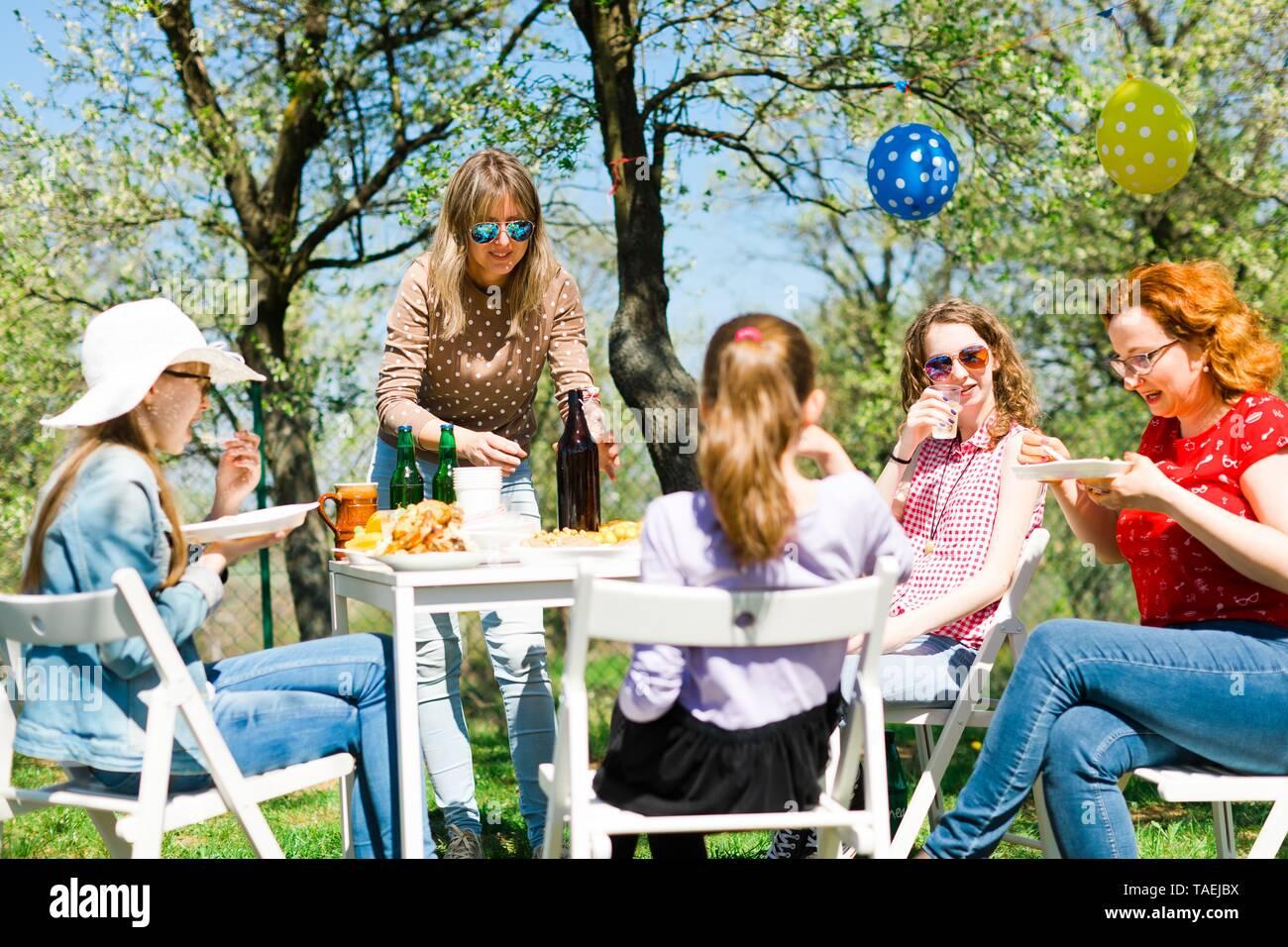 Birthday garden party during summer sunny day on backyard, outdoor picnic Stock Photo