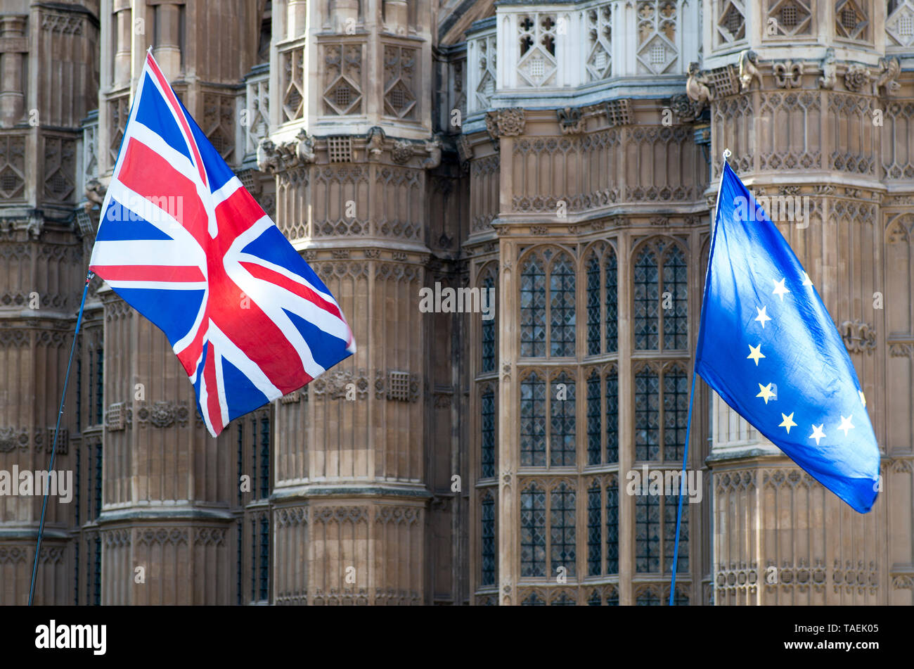 London, UK. 23 April 2019. Union jack and the EU flag flutter near parliament on European election day in the UK, Westminster, London. Lady Chapel of Westminster Cathedral is in the background.  © Stuart Walden/ Alamy - Stock Image