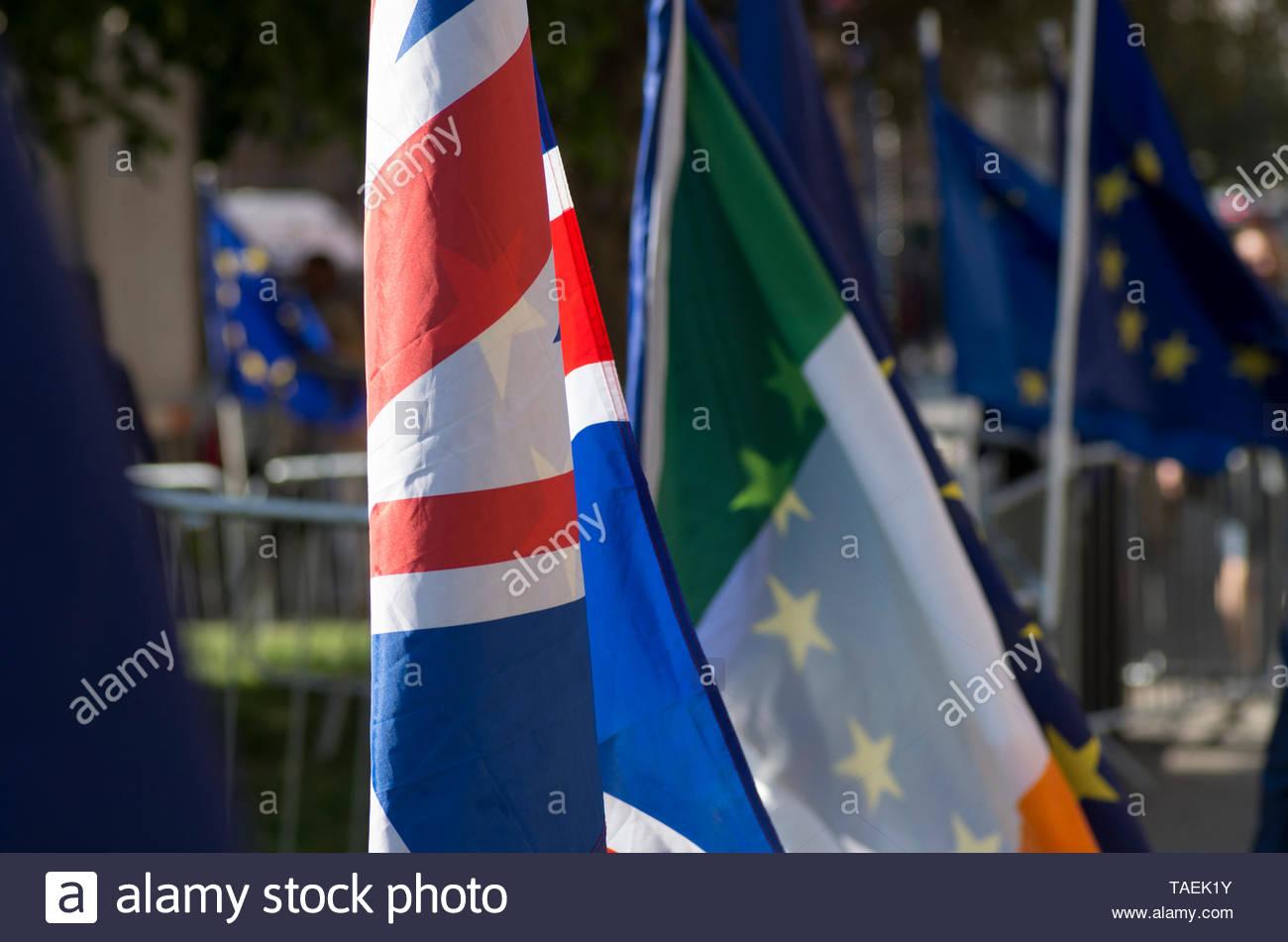 London, UK. 23 April 2019. Union jack, Irish tricolour and the EU flag flutter near parliament on European election day in the UK, Westminster, London.   © Stuart Walden/ Alamy - Stock Image