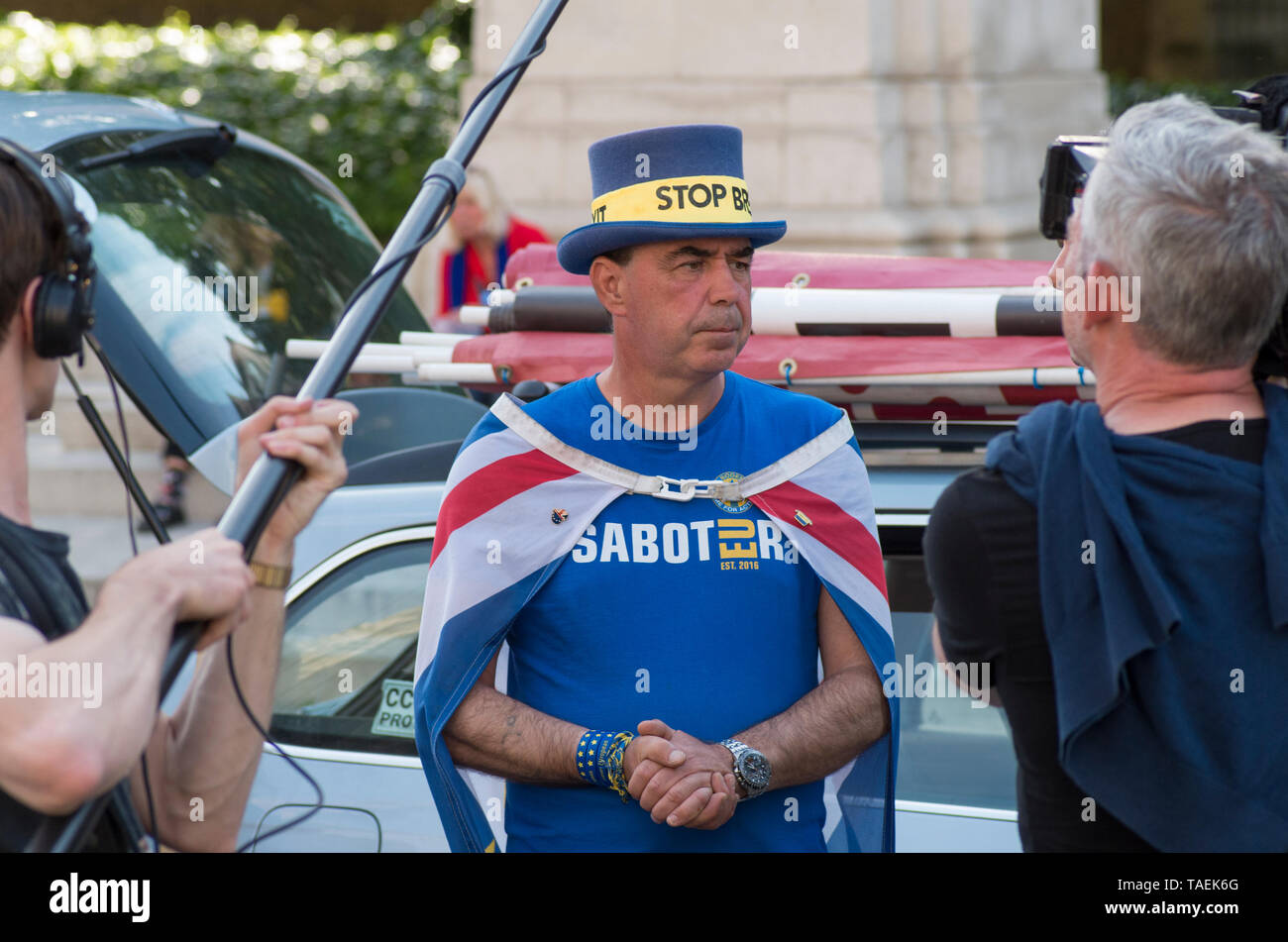 London, UK. 23 April 2019. Steve Bray, is interviewed by media near parliament on European election day in the UK, Westminster, London. Steve is an activist from Port Talbot in south Wales, who makes daily protests against Brexit in College Green, Westminster. He is known by some as Mr. Stop Brexit.  © Stuart Walden/ Alamy - Stock Image