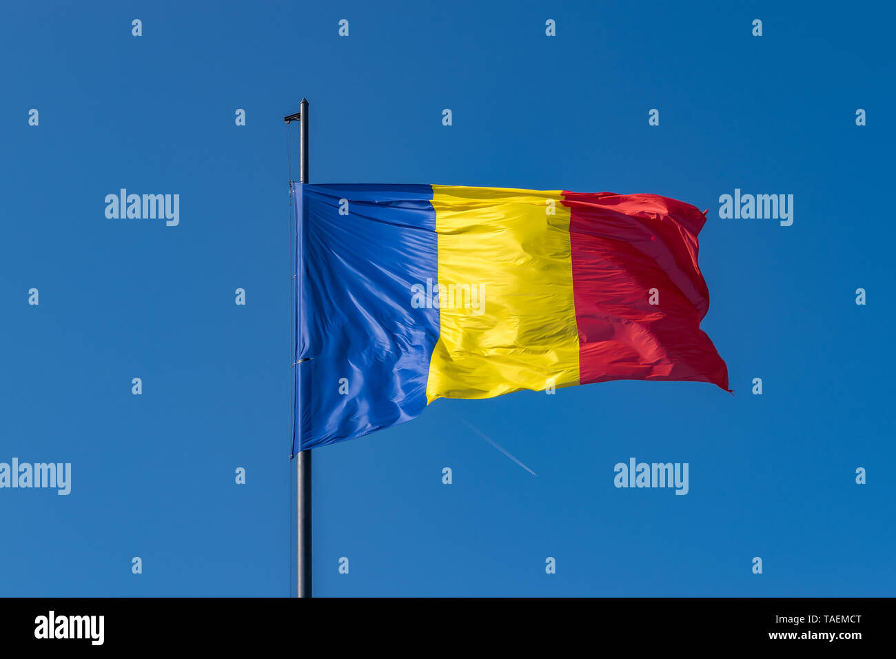 Romanian flag waving on a sunny summer day in Alba Iulia, Romania. Stock Photo