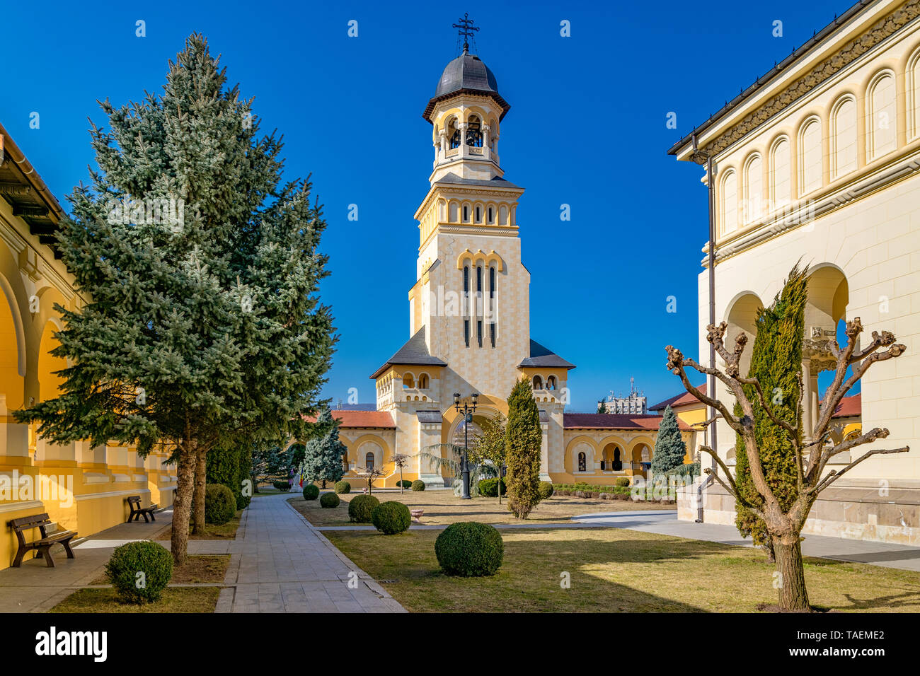 Beautiful view to the Coronation Reunification Cathedral Bell Tower in Alba Iulia city, Romania. A Bell Tower on a sunny day in Alba Iulia, Romania. Stock Photo