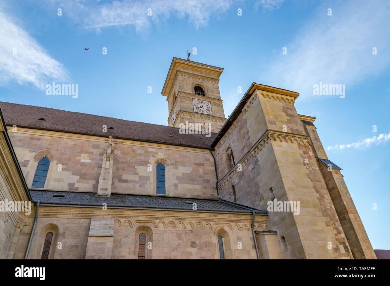 Beautiful view to the Roman-Catholic Cathedral Saint Michael in Alba Iulia city, Romania. A church a sunny day in Alba Iulia, Romania. Stock Photo