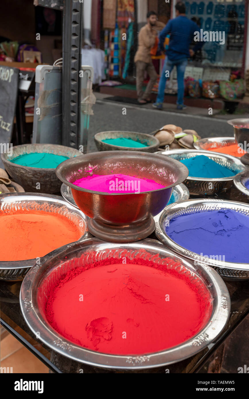 Vertical close up view of coloured powder for sale in India. - Stock Image