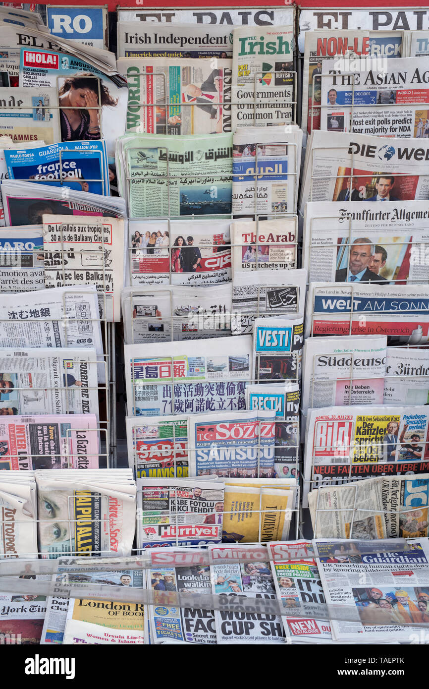 Different nationality newspapers on a stand in The Kings road, Chelsea, London - Stock Image