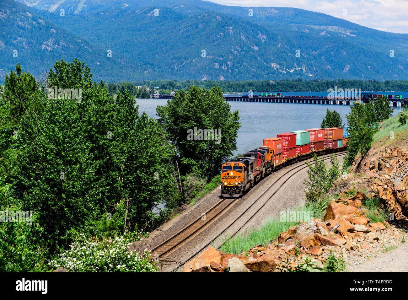 BNSF train along Lake Pend Oreille near Sandpoint, Idaho, USA - Stock Image