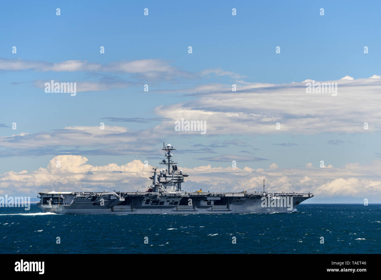 The US nuclear powered aircraft carrier USS John C. Stennis (CVN-74) in the Strait of Juan de Fuca near Port Angeles, Washington State, USA - Stock Image