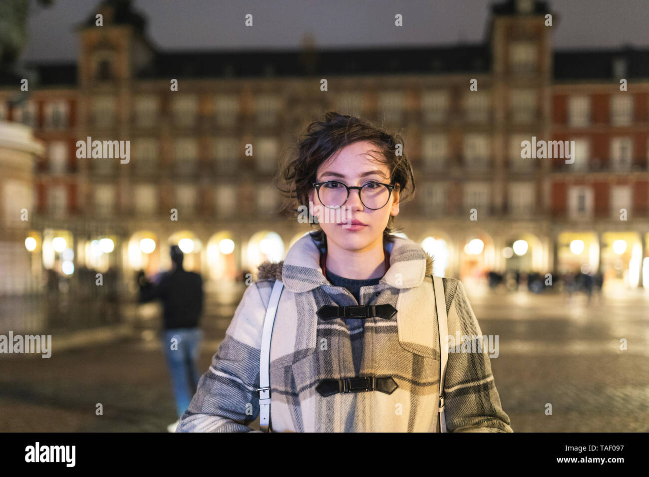 Spain, Madrid, portrait of young woman on Plaza Mayor - Stock Image