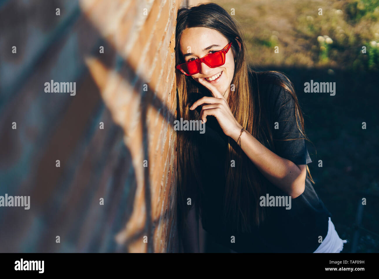 Spain, portrait of a happy teenage girl - Stock Image