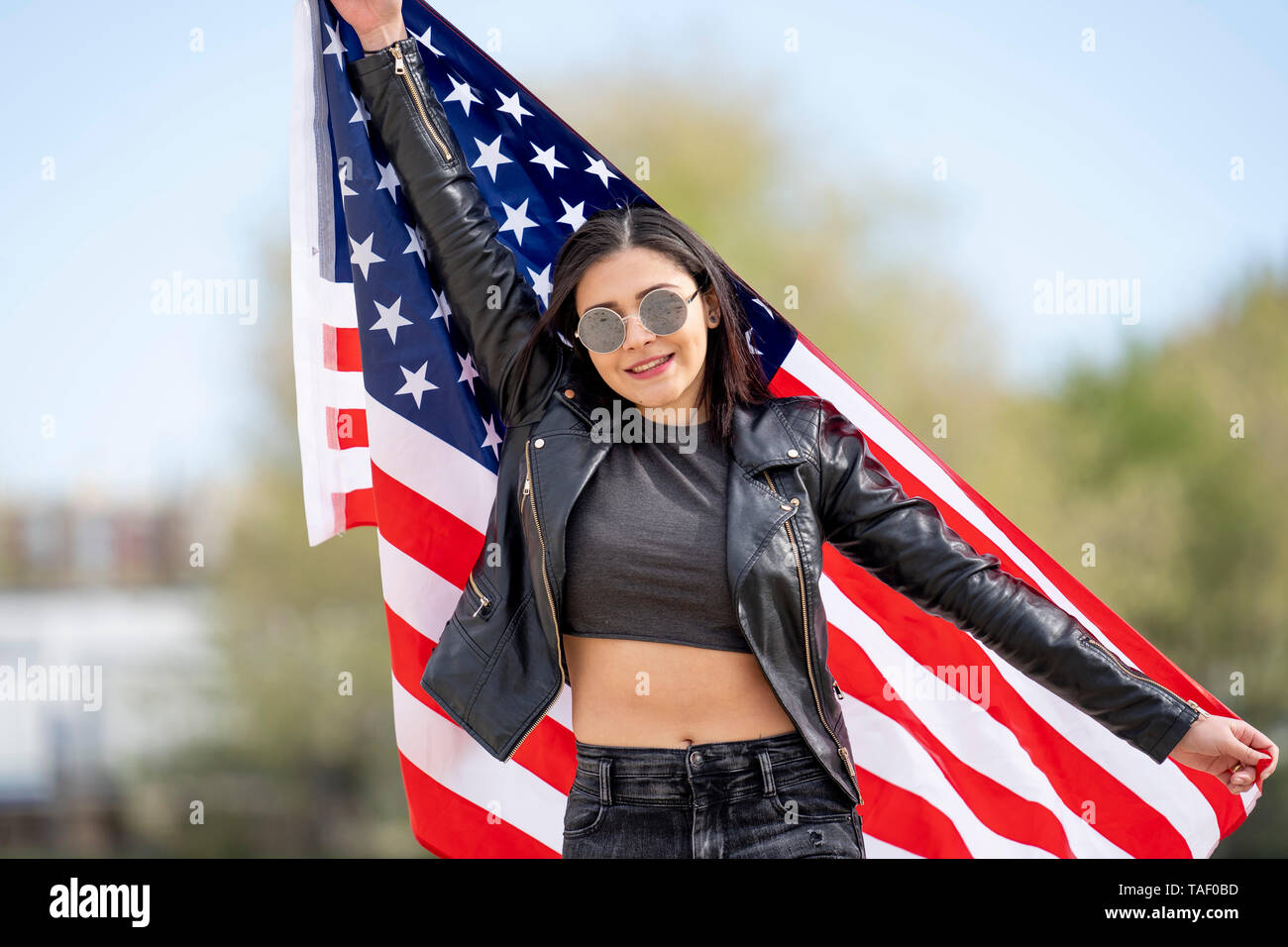 Young woman with american flag - Stock Image