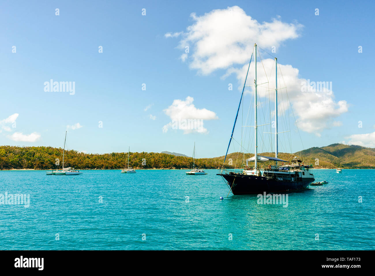 Australia, Queensland, Whitsunday Islands, boats and ship in water - Stock Image
