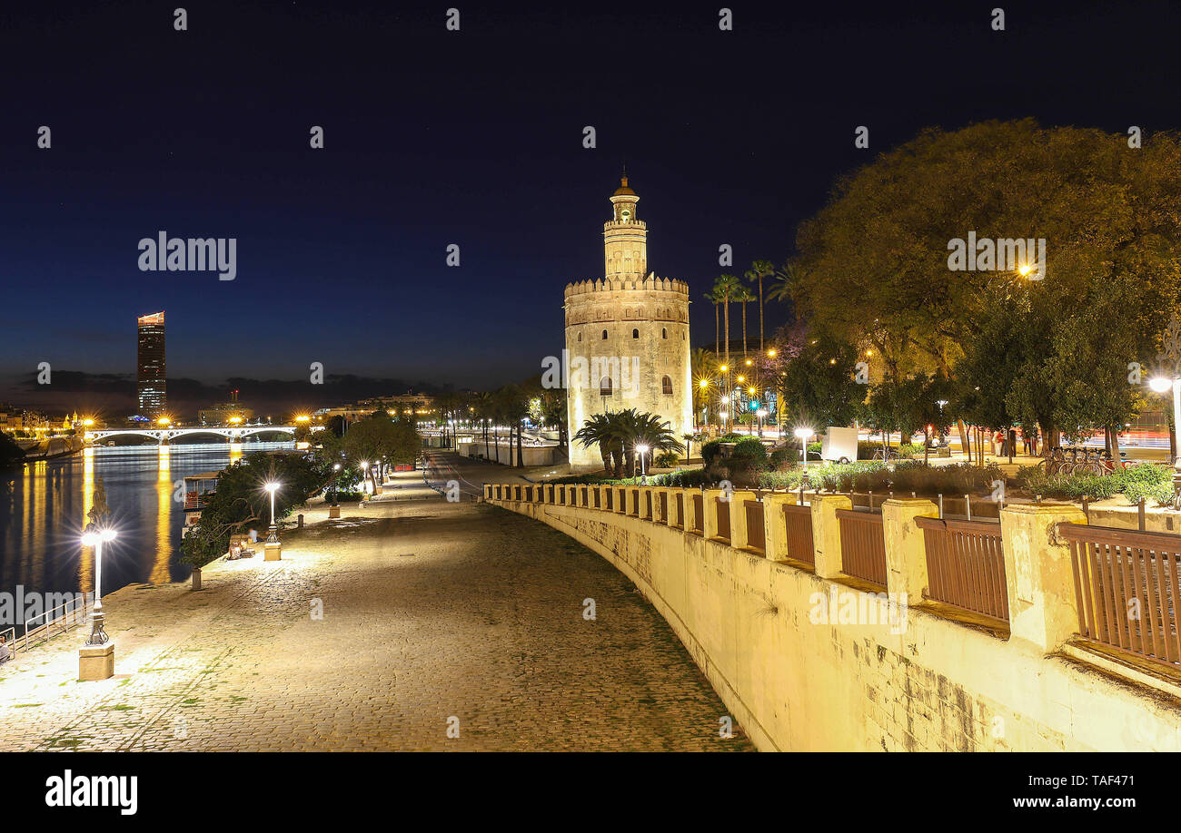 Torre del Oro -Tower of Gold on the bank of the Guadalquivir river at night , Seville, Spain - Stock Image