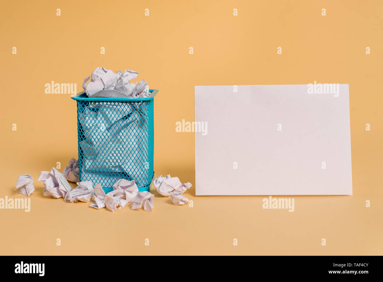 crumpled paper trash and stationary with empty paper placed in trash can - Stock Image