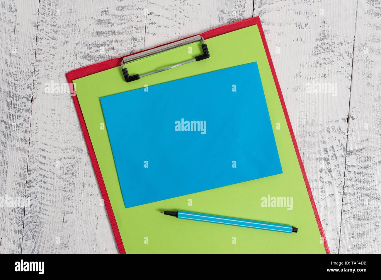Colored clipboard blank paper sheet marker sticky note wooden background - Stock Image