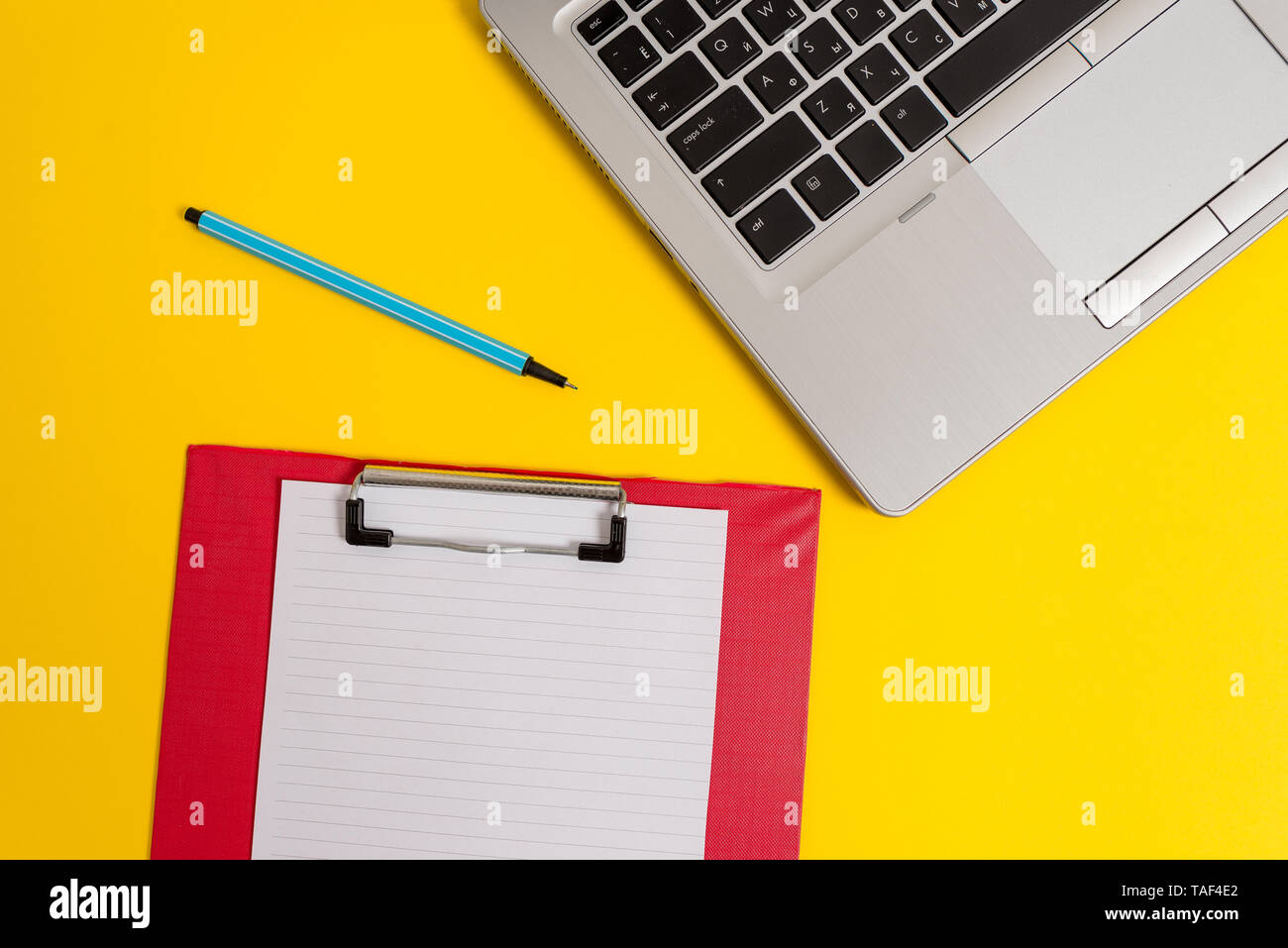 Trendy metallic laptop clipboard paper sheet marker colored background - Stock Image