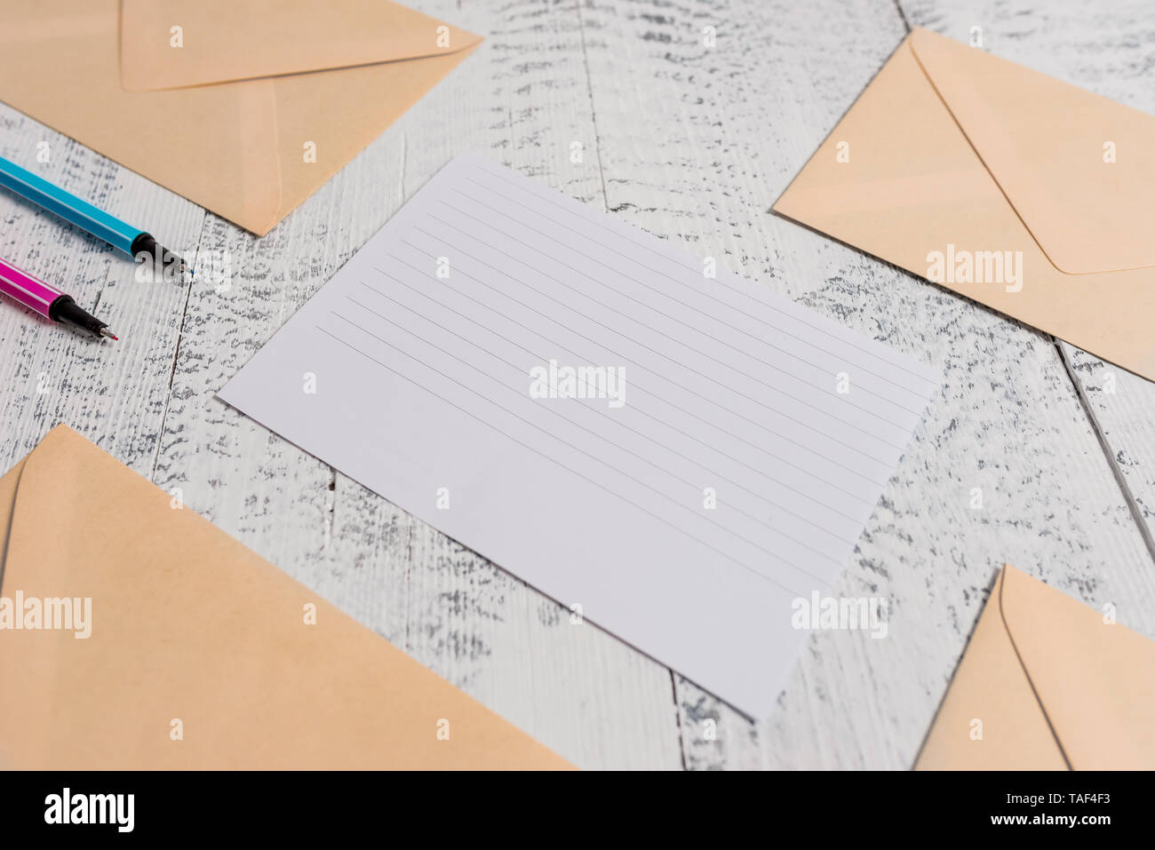 Envelopes highlighters ruled paper sheet wooden retro vintage background - Stock Image