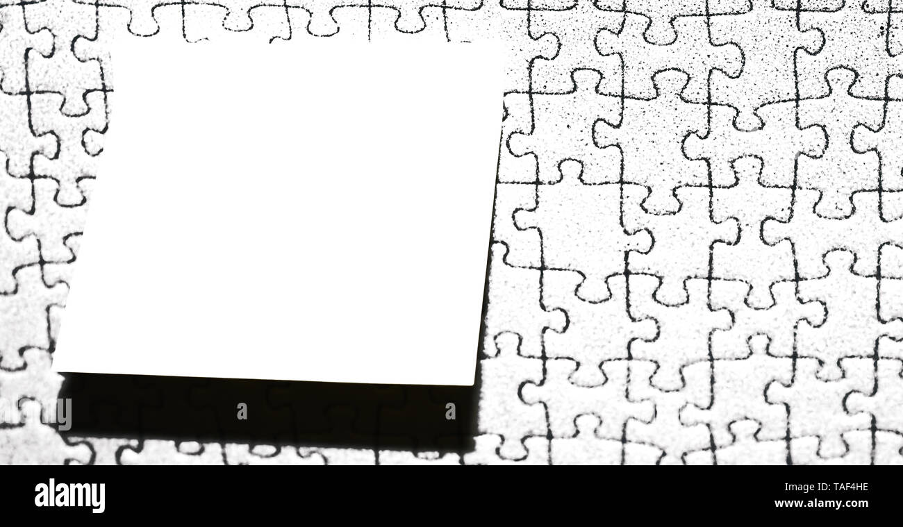 Piece of square note paper use for give notation stick to puzzle background - Stock Image