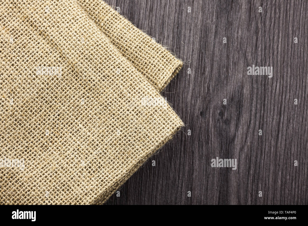 Front view wooden background blank textile, jute linen, tag. Fabric design - Stock Image