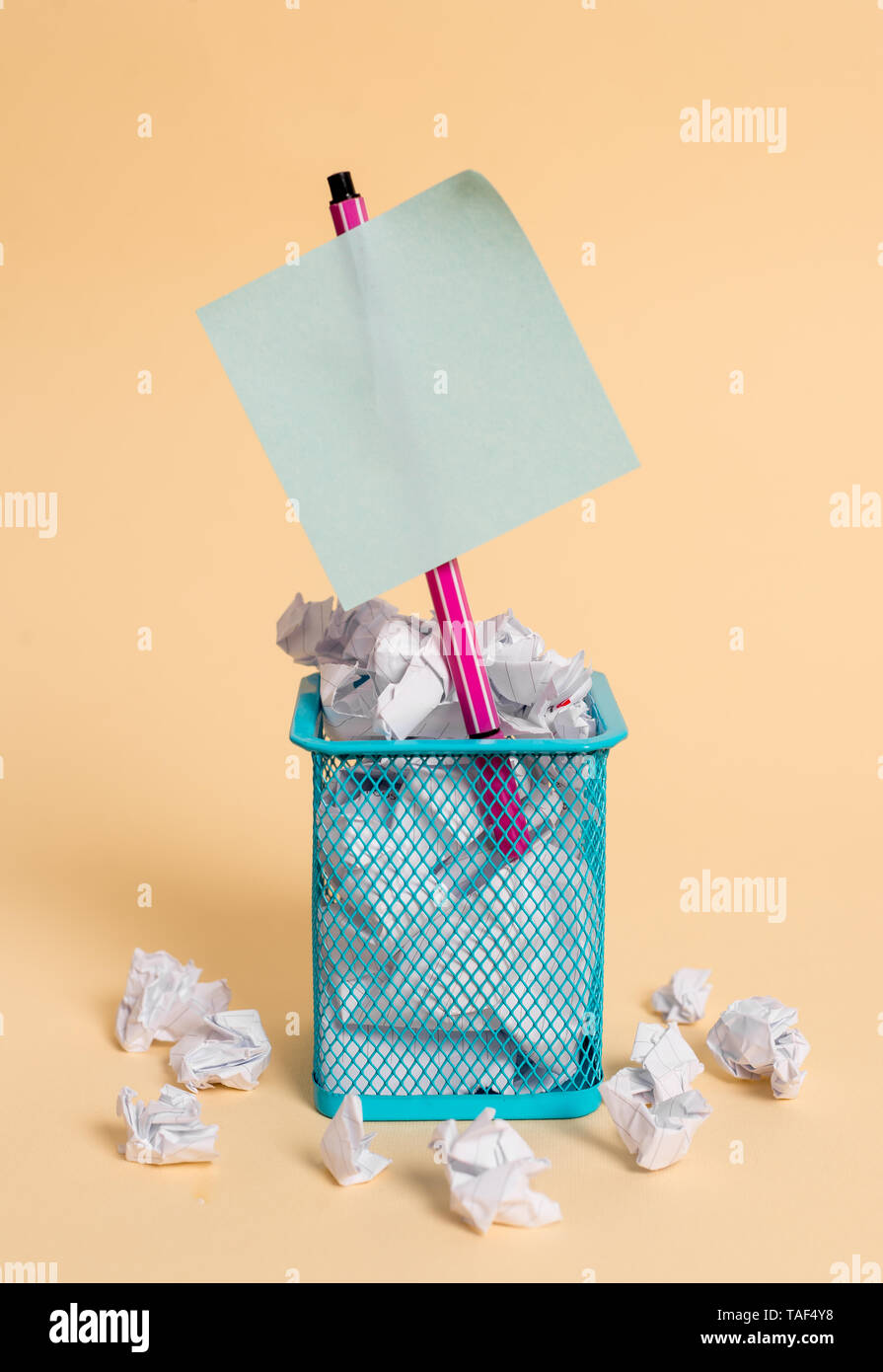crumpled paper trash and stationary with note paper placed in the trash can - Stock Image