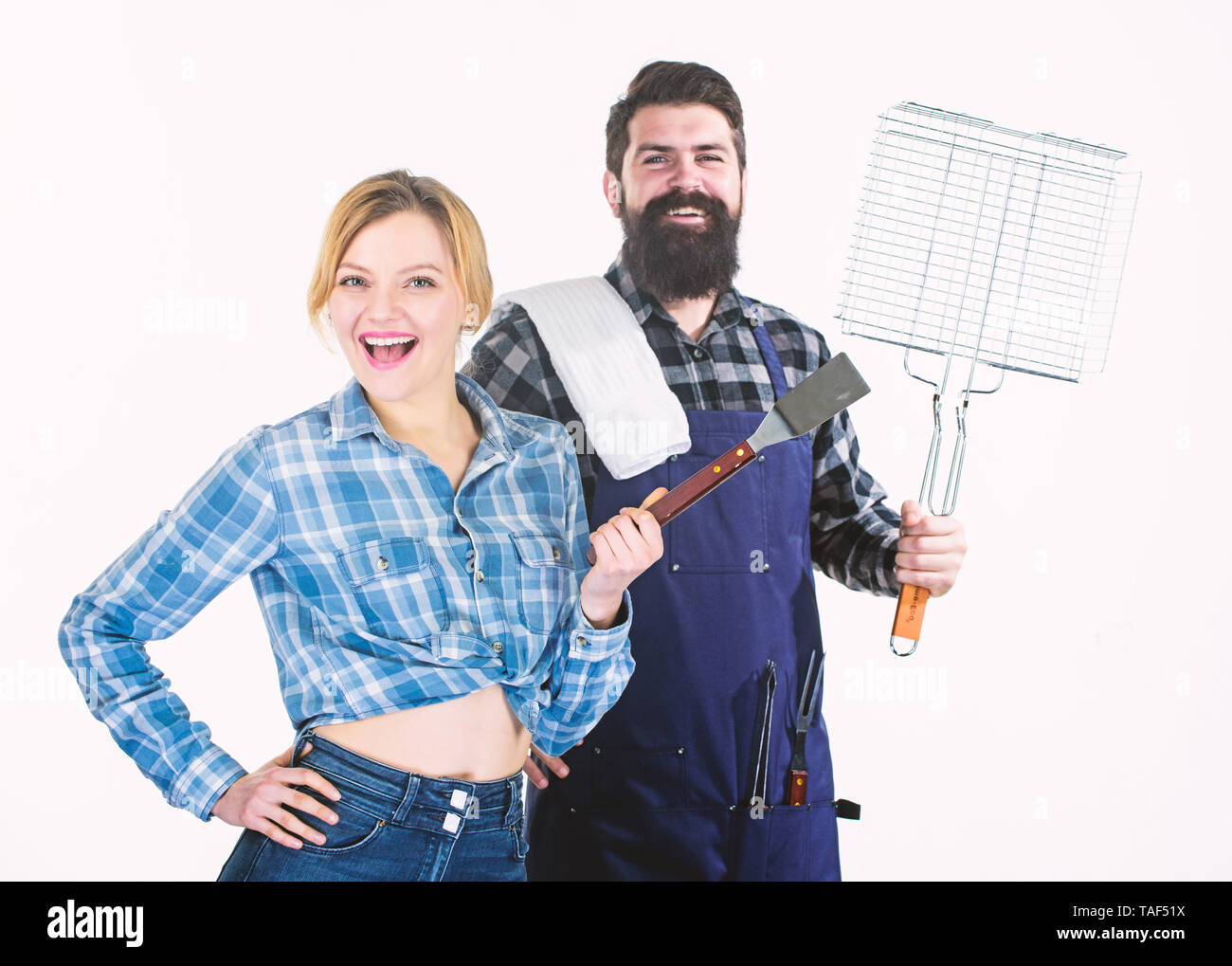 Having great time together. Man bearded hipster and girl. Preparation and culinary. Picnic barbecue. food cooking. Couple in love hold kitchen utensils. Family weekend. Tools for roasting meat. - Stock Image