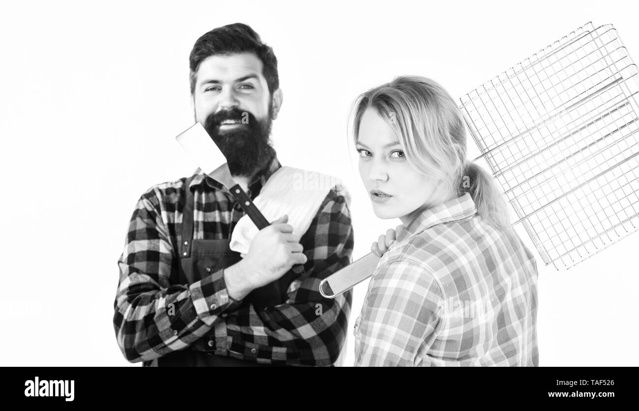 Picnic barbecue. food cooking recipe. Family weekend. Couple in love hold kitchen utensils. Man bearded hipster and girl. Preparation and culinary. Tools for roasting meat. Perfect picnic. - Stock Image