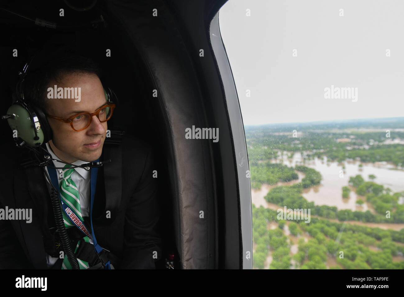 Tulsa Mayor G.T. Bynum inspects the flooding around his city from onboard an Air Force Black Hawk helicopter May 22, 2019 in Tulsa, Oklahoma. More than 1000 homes have been effected by the floods brought by extreme rain accompanied by tornados. - Stock Image