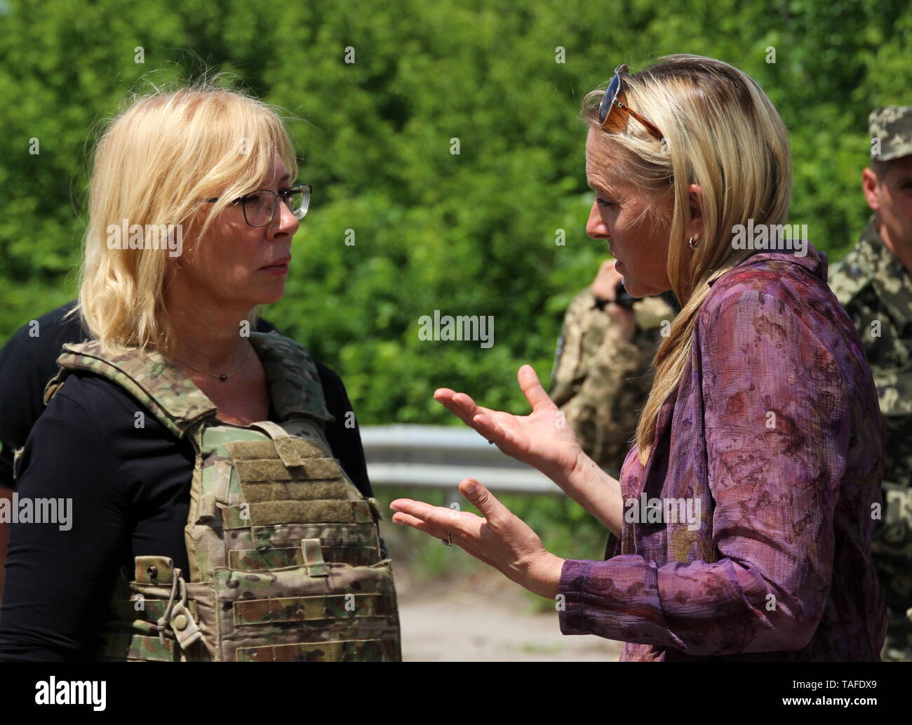 Ukraine. 24th May, 2019. LUGANSK REGION, UKRAINE - MAY 24, 2019: Lyudmyla Denisova (L), Ukraine's Commissioner for Human Rights, and Olga Kobtseva representing the Lugansk People's Republic in the humanitarian subgroup of the Trilateral Contact Group on Ukraine, meet as the republic transfers 60 prisoners convicted before the 2014 Ukrainian crisis, to Ukraine. Alexander Reka/TASS Credit: ITAR-TASS News Agency/Alamy Live News - Stock Image