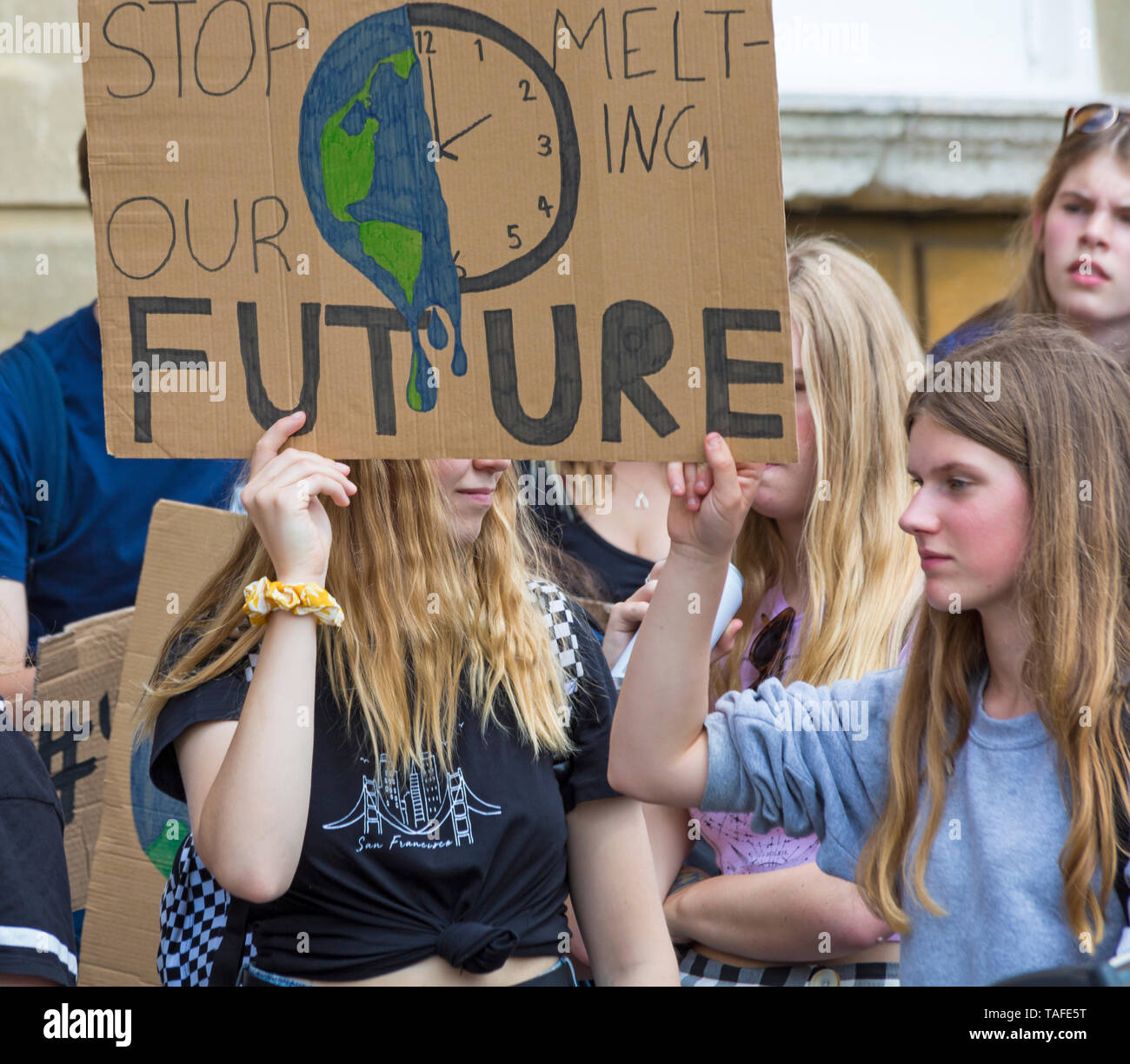 Bournemouth, Dorset, UK. 24th May 2019. Youth Strike 4 Climate gather in Bournemouth Square with their messages about climate change, before marching to the Town Hall.  Stop melting our future sign. Credit: Carolyn Jenkins/Alamy Live News Stock Photo