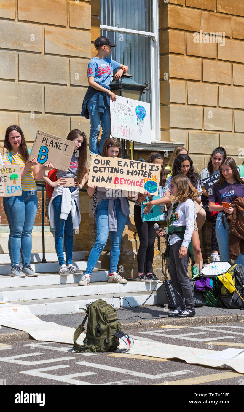 Bournemouth, Dorset, UK. 24th May 2019. Youth Strike 4 Climate gather in Bournemouth Square with their messages about climate change, before marching to the Town Hall where a long letter on wallpaper roll signed by supporters was received by Simon Bull.  Our Earth is getting hotter than Beyonce sign. Credit: Carolyn Jenkins/Alamy Live News Stock Photo