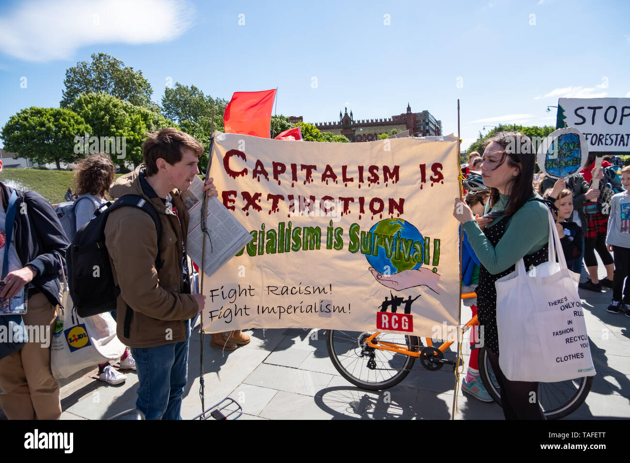 Glasgow, Scotland, UK. 24th May, 2019. A banner saying Capitalism Is Extinction Socialism Is Survival Fight Racism Fight Imperialism is carried during the Youth Strike 4 Climate student demonstration. Students across the UK are protesting against climate change and the lack of action by the Government.  Credit: Skully/Alamy Live News - Stock Image