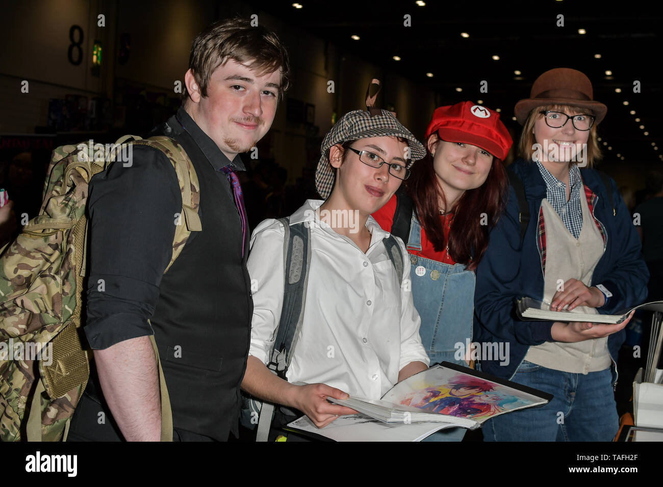 Comic fans looking at a stall GuiZang (www.guizang.co.uk) by artist Qing Qi at MCM Comic Con London on May 24, 2019. Credit: Picture Capital/Alamy Live News Stock Photo