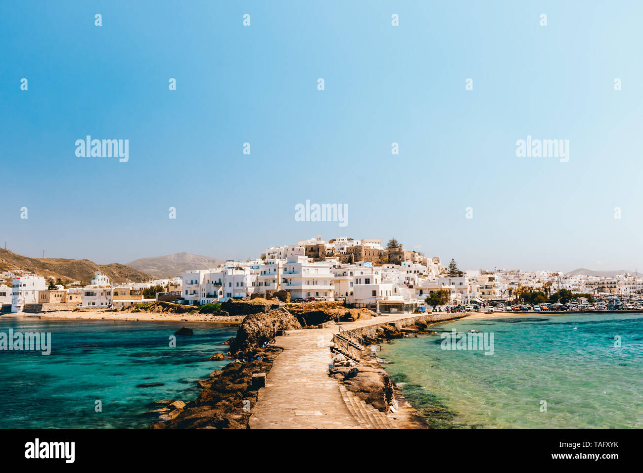 Cityscape of Naxos town on a sunny day, Naxos, Greece - Stock Image